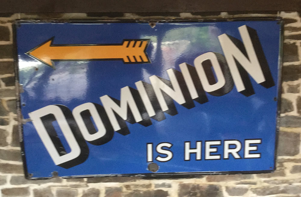 Dominion is Here Enamel Sign